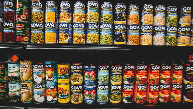 A picture depicting shelves of canned goods.
