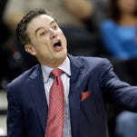 Louisville head coach Rick Pitino directs his team against Wake Forest during the first half of an NCAA college basketball game in Charlotte, N.C., Sunday, Jan. 4, 2015. (AP Photo/Chuck Burton)