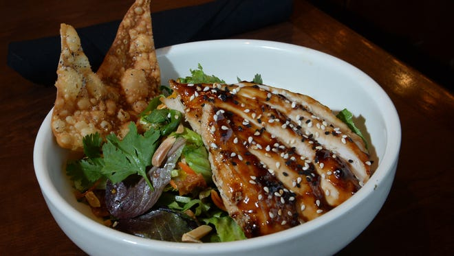 Warm Asian glazed chicken salad at Bazille at The Oaks.