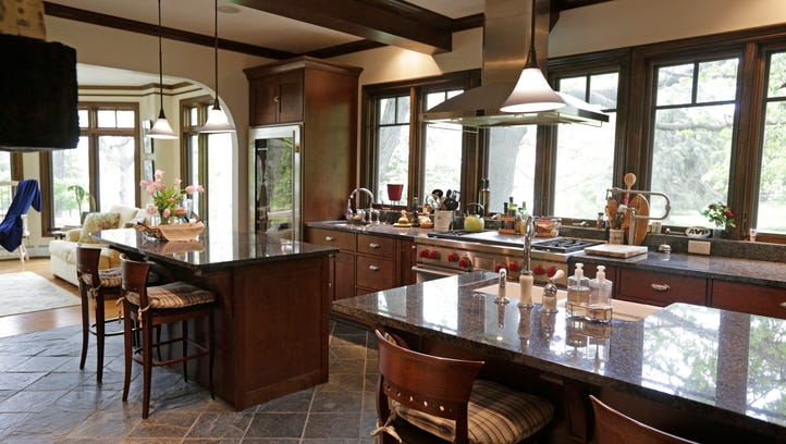 The kitchen features custom handcrafted cherry cabinetry