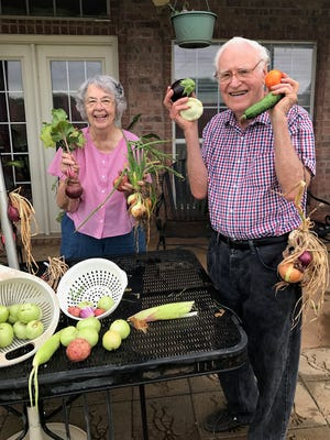 Margie and Charles G. Anderson Sr. grow much of their own produce in their back-yard garden in summer 2017.