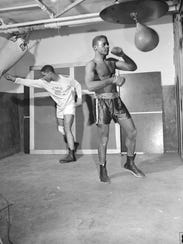 Moe Manier (left) and George Whitcomb training for the Golden Gloves tournament