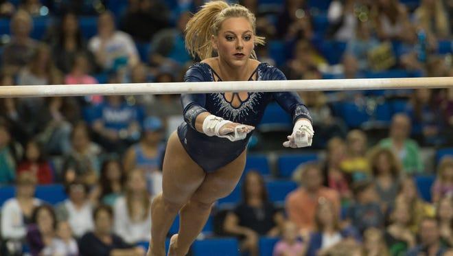 UCLA gymnast Samantha Peszek performs on uneven bars in Jan. 19 meet against Arizona at Los Angeles