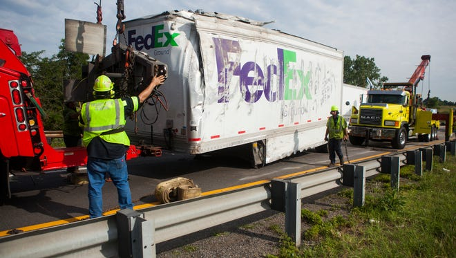 Incident responders work to remove a wrecked FedEx ground trailer from I-81 near mile marker 225 after an accident on Thursday, June 25, 2015.