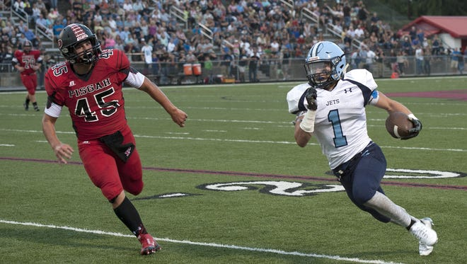 Enka's Michael Cantrell (1) has rushed for more than 1,000 yards.