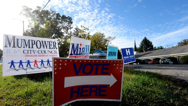 Campaign signs surround a directional sign at Kenilworth Presbyterian Church as voters take to the polls for the Asheville City Council primary election on Tuesday, Oct. 6, 2015.