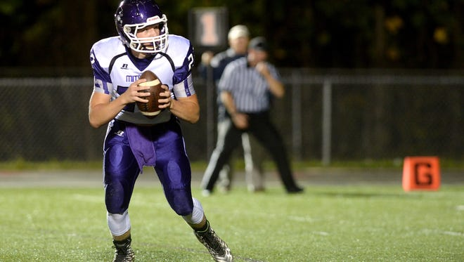 Mitchell quarterback Ben Young.