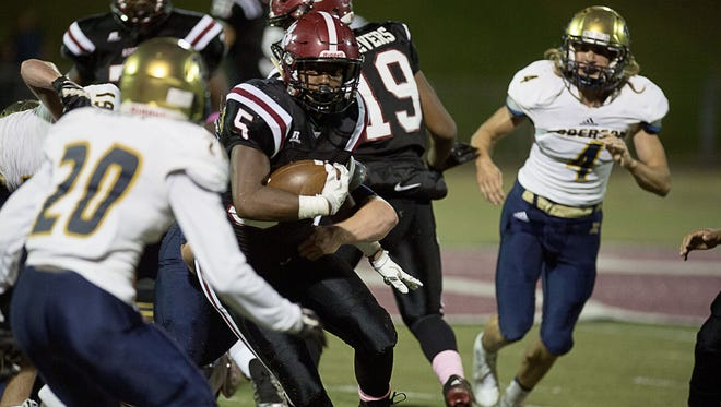 Asheville High's Reggie Battle weaves through the Roberson defense on Friday.