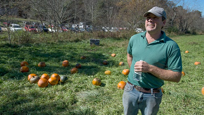 Owner of Hickory Nut Gap Farm Jamie Ager talks about farming out on his farm's pumpkin patch Wednesday October 21, 2015.
