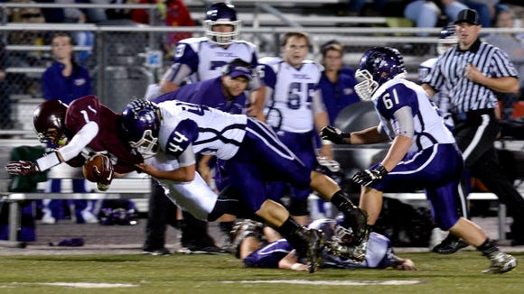 Mitchell's Jacob Yelton (44) makes a tackle during a game last month at Owen.