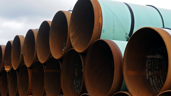 A 2012 photo shows piping to be used for the Keystone XL pipeline.
