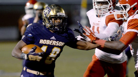 Roberson's Dezmond Moorman carries the ball in Friday's playoff loss to Fayetteville Seventy-First.