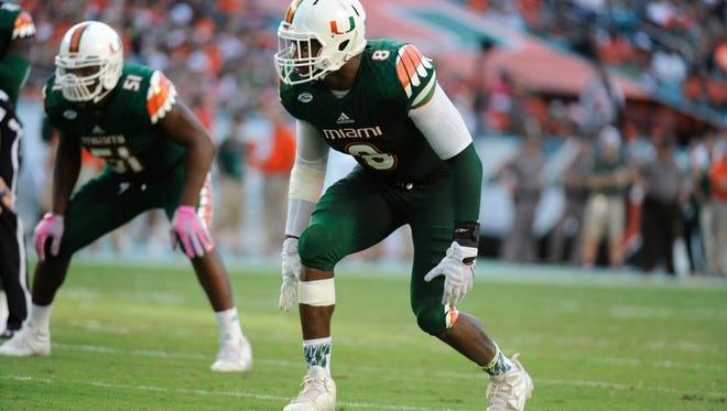 Al-Quadin Muhammad is one of the leaders for the Hurricanes on defense.