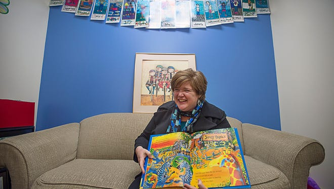 Therapist Ashley Fiore holds up a book she uses during her sessions Tuesday Jan. 26 at the new Child Advocacy Center.