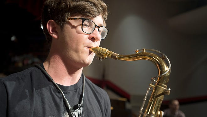 North Buncombe High student Jason Chrisman plays some jazz improvisation Tuesday Feb. 2 in the high school's auditorium. Chrisman, 17, was chosen out of a handful of students nationwide to attend the GRAMMY Jazz Camp in Los Angeles.
