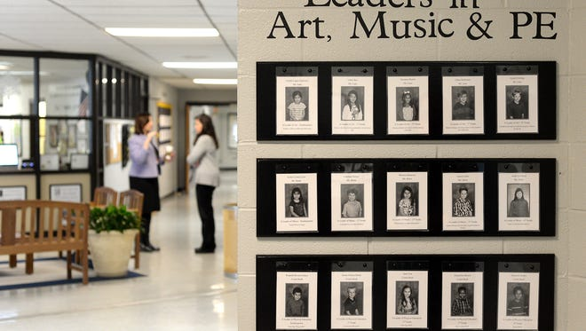 "The names and photographs of students who have been deemed to be leaders are mounted on the wall of William W. Estes Elementary School on Thursday, Feb. 11, 2016. Administrators said through their new ""The Leader in Me"" program they are celebrating children who are leaders in academics, art, music, physical education and beyond."