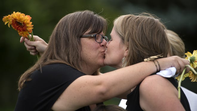 Gretchen Haley, right, and Carri Ratazzi embrace during their marriage ceremony at the Unitarian Universalists Ministries retreat at the Sunrise Ranch in Loveland Monday, Oct. 6, 2014. Larimer County began issuing same-sex marriage licenses Monday afternoon.