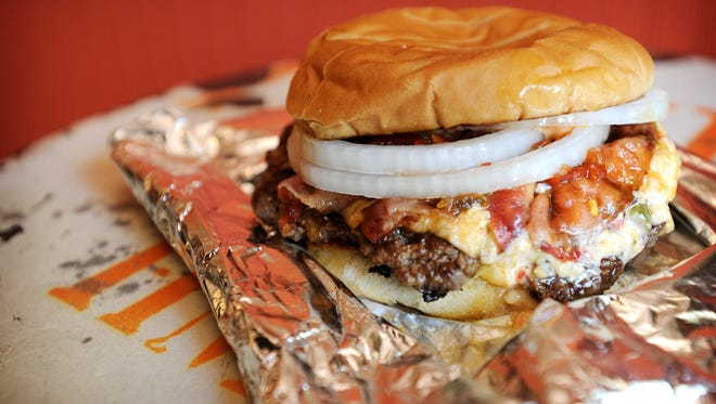 A Burgerworx beef burger with pimento cheese, onions, cherry pepper relish, Sriracha mayo and bacon.