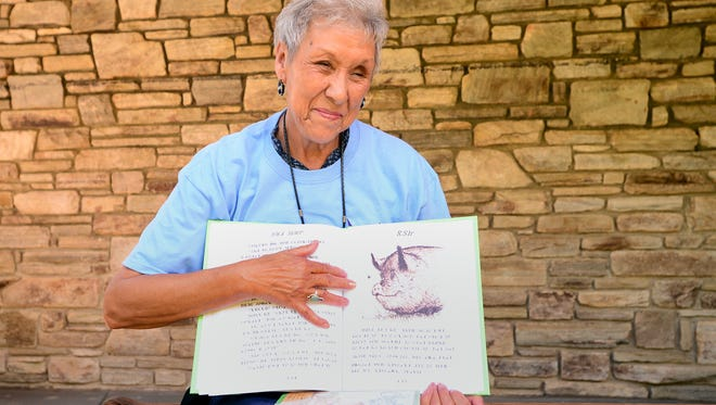 """Myrtle Driver Johnson holds the version of E.B White's children's classic """"Charlotte's Web"""" that she translated from English to the Cherokee syllabary and is used at Kituwah Academy, a language immersion school for preschool through fifth grade. Johnson grew up speaking Cherokee at home and English in school."""