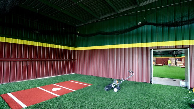 A batting lane in the covered, but outdoor, batting area meets the door to the indoor batting area at D-BAT, a baseball and softball training facility opening next month on Hendersonville Road.