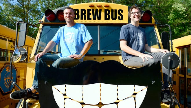 Brothers Zack, left, and J.C. Hayes bought Asheville Brews Cruise in February. The business will celebrate 10 years of operating in Asheville this year. With a fleet of three buses the cruise offers beer tours with stops at local breweries and samples of beer included in the tour price every day but Monday as well as private tours and shuttle services.