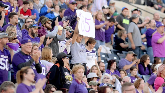 Mitchell football fans cheer on their team during last year's 1-AA state championship game in Winston-Salem.