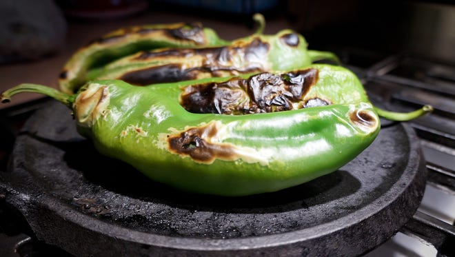 Food preservation experts at New Mexico State University recommend blistering chilesto remove the chile's tough skin. Use a very hot heat source such as an oven broiler, stovetop burner or outdoor grill to blister chile skin, cool in a plastic bag then peel.