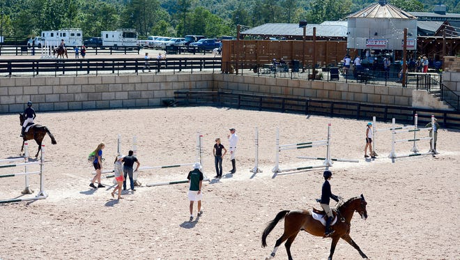 Competitors warm up before their turn at the show jumping competition during the USEA American Eventing Championships at the Tryon International Equestrian Center on Saturday, Sept. 3, 2016.