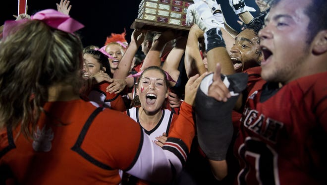 Pisgah players and cheerleaders celebrate after Friday's 23-20 overtime win over Tuscola.