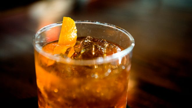 The Pumpkin Old Fashioned is garnished with a slice of orange.