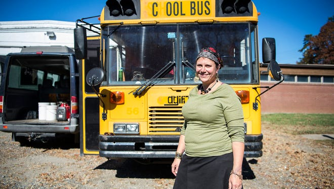 Rosetta Buan, owner of Asheville fixture Rosetta's Kitchen, stands in front of her school bus loaded with kitchen supplies and donated food to take to the Dakota Access Pipeline protestors in North Dakota Friday Nov. 4, 2016 in Asheville. After seeing an online video in September of one woman cooking over an open flame to feed the protestors, Buan took action and has made repeated trips to feed people.