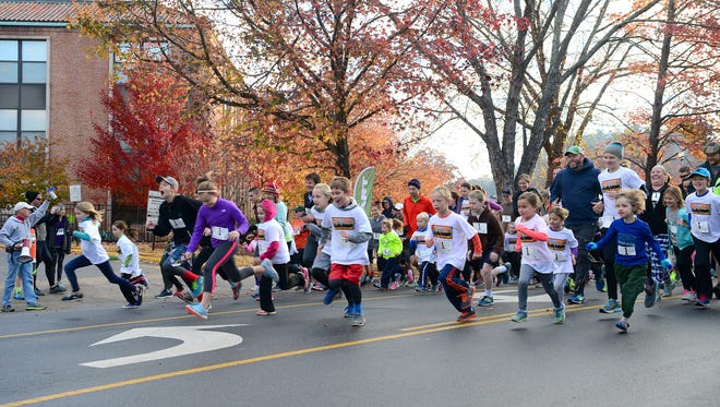 More than 1500 runners started their Thanksgiving Day off with the annual Asheville Turkey Trot and Gobble Wobble fun run downtown on Thursday, Nov. 24, 2016.