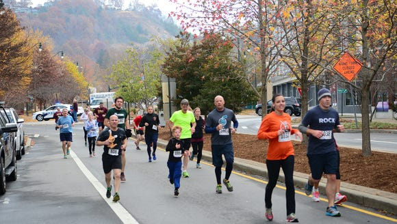 More than 1,500 runners took part in the Jus' Running Turkey Trot 5K last year in Asheville. The running shop will donate a portion of this weekend's sales to the Hope Chest for Women, a cancer charity.