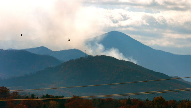 Smoke could be seen rising between the mountains looking West from downtown on Thursday, Nov. 24, 2016.