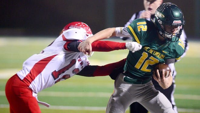 Nathan St. Onge (12) and Reynolds are home for Friday's third round of the NCHSAA 3-AA football playoffs.