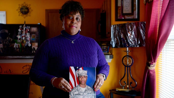 """Connie Easterling holds a photo of her son, Savon, in his military uniform at her home in High Point, N.C., on Wednesday, Dec. 14, 2016. Savon Easterling, 21, was shot and killed in front of his home in Clarksville in August 2015. """"He was a good kid and he shouldn't have had to die the way he did,"""" she said."""