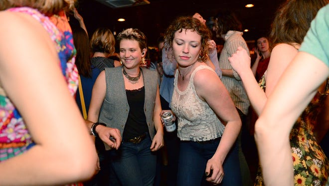 """Madeline Owen, left, and Emma Martin dance during the penultimate Saturday night dance party at The Admiral on Saturday, Dec. 17, 2016. """"This is my happy place,"""" Martin said of the dance parties. """"I don't know what I'm gonna do, I've been here almost every Saturday for the last 5 years."""""""