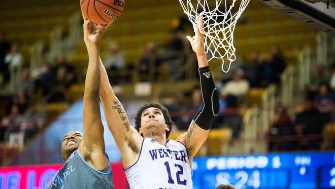 Warren Sledge, left, and Marc Gosselin, right, fight for the ball Friday evening during Western Carolina's Southern Conference game against The Citadel. The Catamounts fell to The Citadel 78-72.