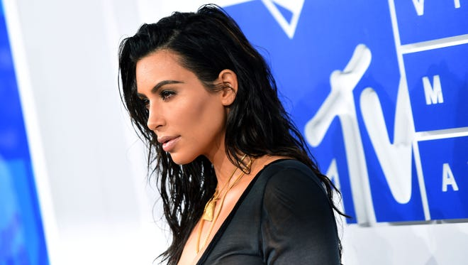 FILE - Kim Kardashian West  attends the 2016 MTV Video Music Awards at Madison Square Garden on August 28, 2016 in New York City. Kim Kardashian West, along with sisters Kourtney and Khloe, shared multiple shots on their Instagram, Snapchat and Twitter accounts as they traveled into the Coachella Valley Sunday.