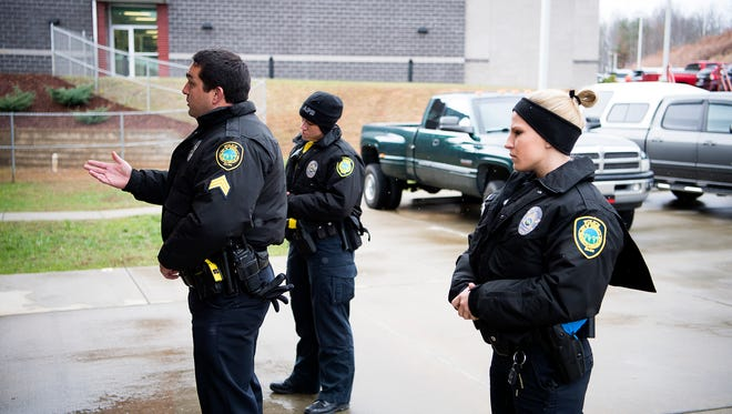During a training exercise, Asheville police officers talk to a man to practice de-escalating the situation at the Woodfin training facility as part of an integrated training approach designed to help officers safely diffuse situations.