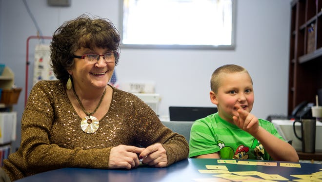 """Delores Elliot """"Grannie Dee"""" and second-grader Hayden Virtanen laugh during a reading exercise March 8 at Andrews Elementary."""