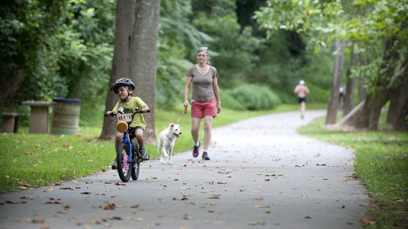 The Buncombe County Greenways Commission and Pisgah Brewing Co. host the 10th annual Greenway Challenge in Black Mountain to help support greenways, such as this path through Hominy Creek River Park.