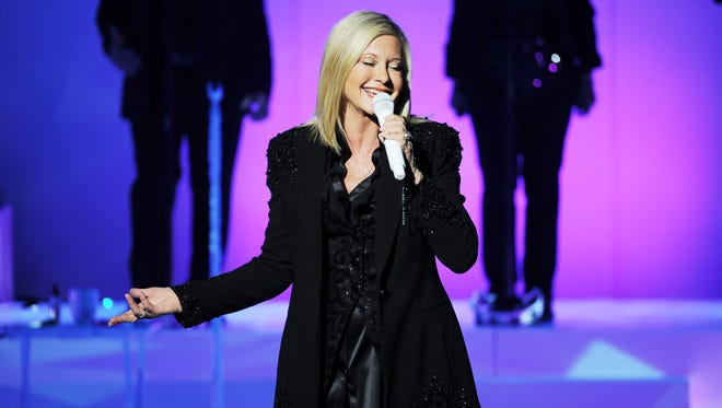 Olivia Newton John performs in 2014.
