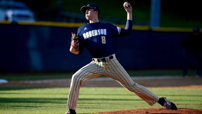 Junior Eric Wallington pitched a complete game for Roberson on Thursday.