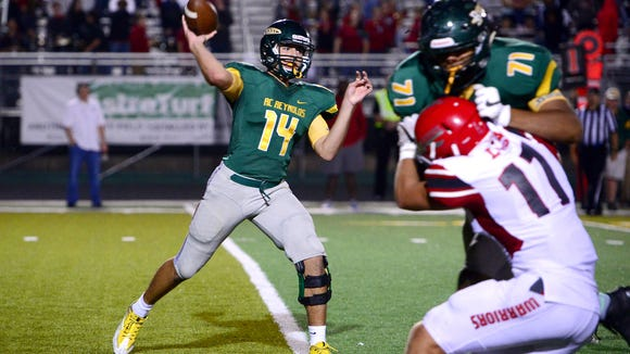 Reynolds quarterback Alex Flinn throws a pass during Reynolds' game against Erwin at Reynolds High School on Friday, Sept. 8, 2017. The Rockets defeated the Warriors 49-34.