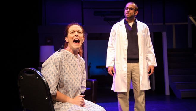 """Carrie Gray (left) portrays a mother who struggles with bipolar disorder in the rock musical """"Next to Normal."""""""