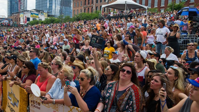 Fans pack downtown Nashville during the CMA Music Festival on June 11, 2017.