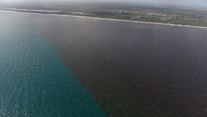 Dirty water from the Indian River Lagoon empties into the Atlantic Ocean through the St. Lucie Inlet in Stuart, discoloring the water south along the beaches of Hobe Sound as seen on Wednesday, Oct. 11, 2017, in southern Martin County. Excess water from Lake Okeechobee released through the St. Lucie Locks flowing along the St. Lucie River in Martin County empties into the Indian River Lagoon, causing toxic conditions and discoloration in the lagoon, which eventually flows through the inlets into the Atlantic Ocean with the changing tides.