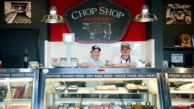 Matt Helms, general manager, and PJ Jackson, head butcher, at The Chop Shop work together to provide quality meat including dry aged beef that can take months to prepare for sale.