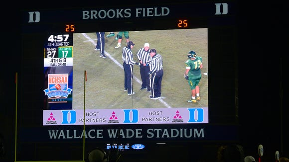 The scoreboard and video replay screen at Wallace Wade Stadium during he NCHSAA 3AA football state championship game between Reynolds and New Hanover on Saturday, Dec. 9, 2017.